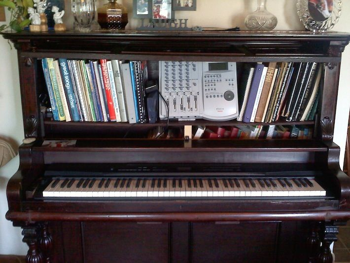 Repurposed upright piano, made into a synthesizer stand with bookshelf. If you had an old broken piano