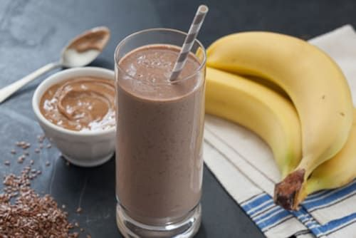 Yogurt with live cultures and natural peanut butter form the protein base of this creamy breakfast smoothie. Sweetened with dates and gently spiced with cardamom, it also includes flaxseed oil, which provides beneficial omega-3 fatty acids.