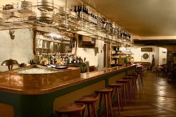Brass shelving....An Urban Oyster Bar in NYC : Remodelista