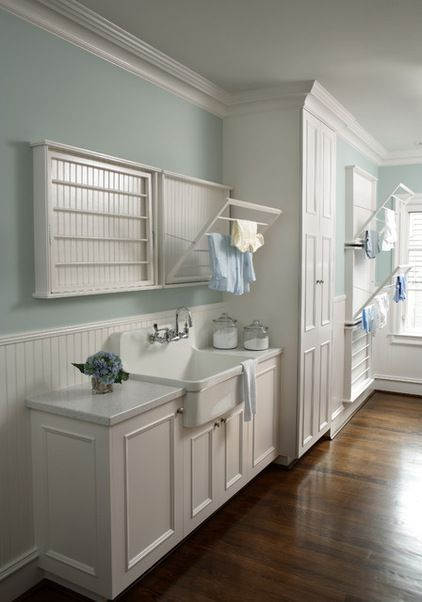 Traditional laundry room with built-in drying racks by Rabaut Design Associates, Inc.