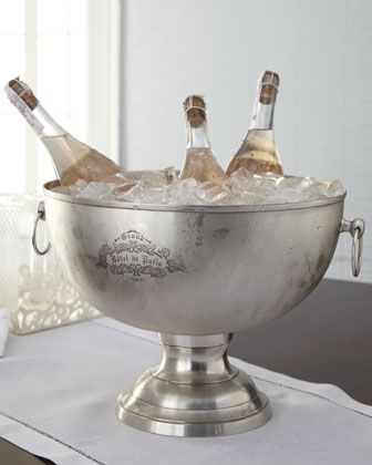 This gorgeous beverage tub just screams 'Party!' And when guests arrive with gift bottles of wine and champagne, they can be opened immediately and go directly into the inviting party centerpiece for easy access.