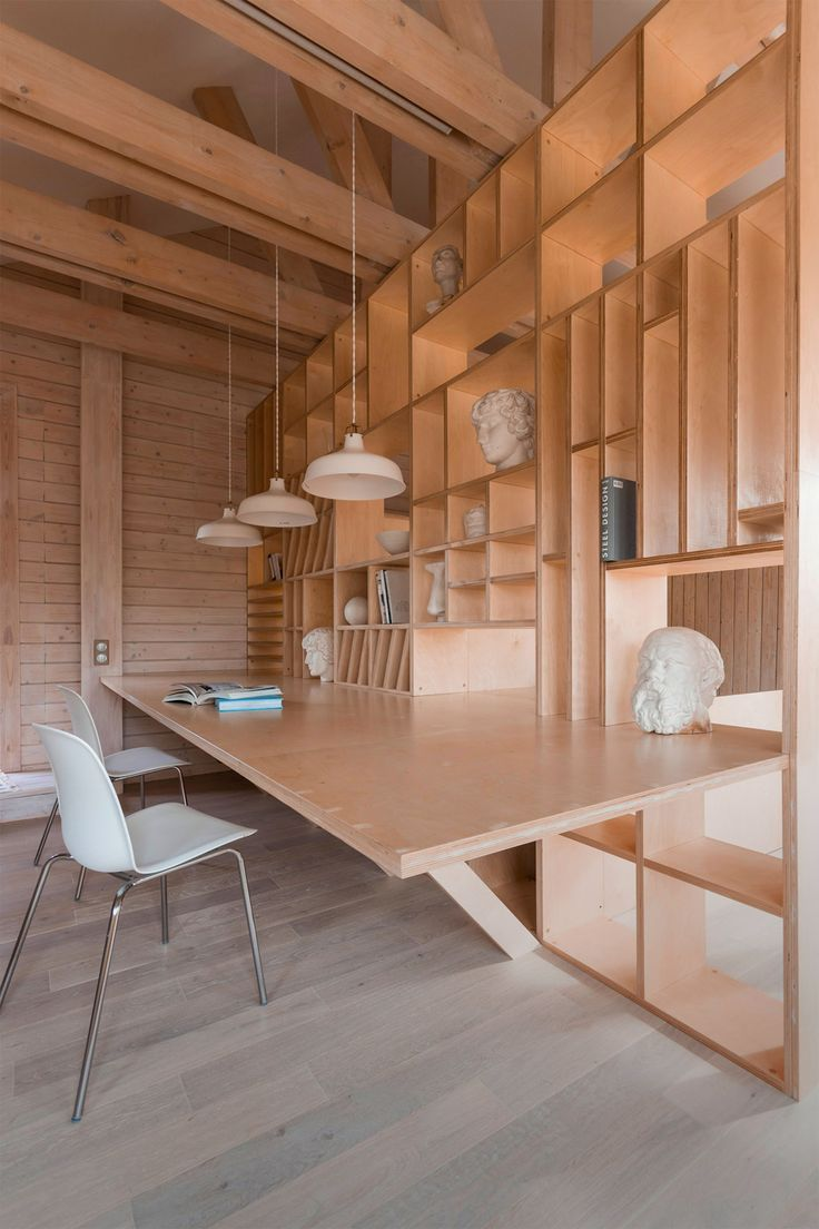 Room Dividers Shelves - Artist s studio by ruetemple is designed in a single wooden unit