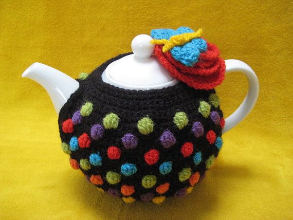 Get yourself into the happy mood with a multi coloured Polka Dot tea cosy on your table ! A tea cosy like this will make a lovely personal handmade gift for any tea lover. This --- PATTERN --- will guide you to crochet a teacosy as shown in picture, made from soft acrylic yarn (wool or cotton will be suitable too) and crochethook G (4 mm).  Size of this teacosy will be approx. 6.70 inch (17 cm) tall. This is a great project for using up your scraps of yarn, because of the coloured bobble…