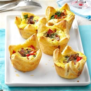 "Quiche Pastry Cups Recipe -My grandmother used to make ""egg cup surprises"" for family brunches on special occasions. The added fillings were always a surprise as she never seemed to use the same combination of ingredients twice. As children, we had a guessing game as to what we'd find under the tender crust, which added an aspect of family fun to our meal.—Denalee Standart, Rancho Mureta, California"