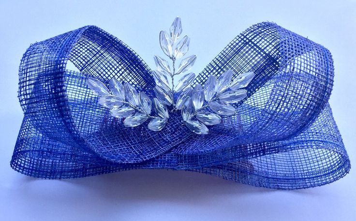 A personal favourite from my Etsy shop https://www.etsy.com/au/listing/250813820/blue-sinamay-fascinator-with-crystal