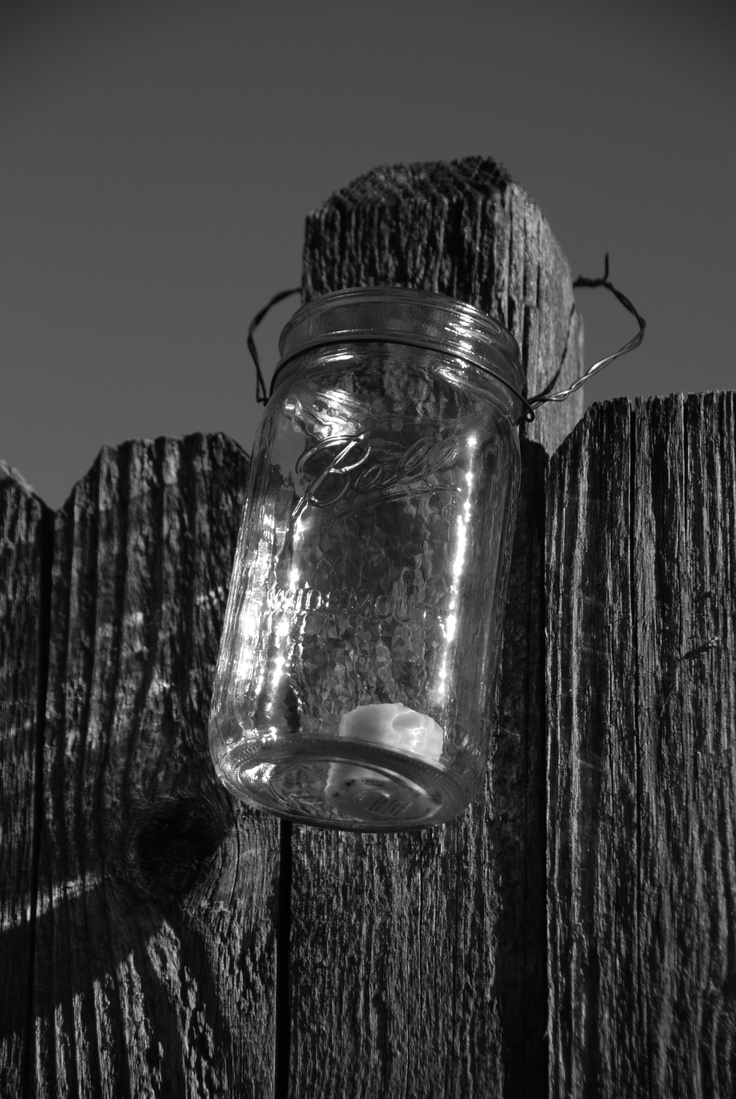 mason jars on the fence post