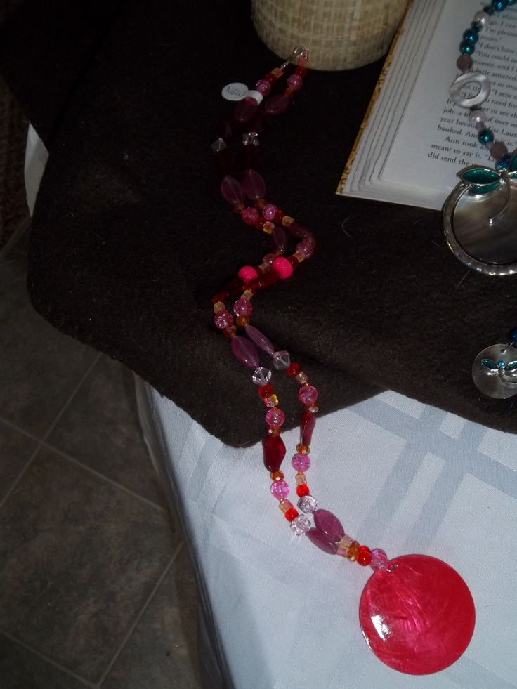 Longer pink necklace with shell pendant