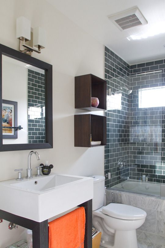 """The """"Pockets Shower Curtain"""" shown on this site is a great idea for a less cluttered vanity. Instead of pictures, you could put all your small things like bobby pins, hair ties, make up, barrettes, cotton balls, etc. in the pockets for easy access. I wouldn't over weight it though; it could tear from the rod."""