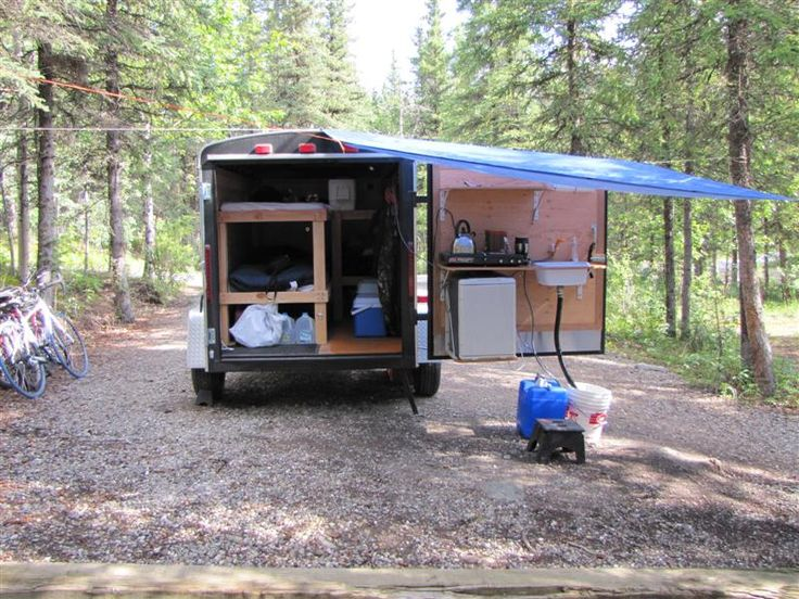 Anyone here build a tiny trailer? This one has a 12V fridge, 12V water pump with sink (can be used for showers too), lights, stove and two bunks and tons of storage. Will bring a bigger tarp next time