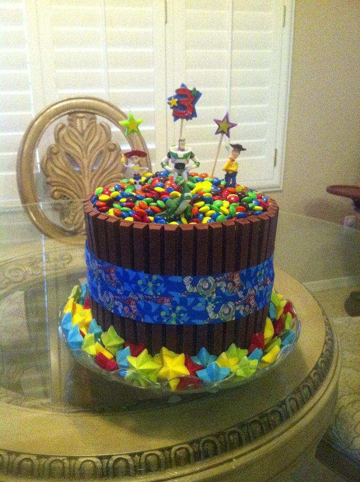 Rainbow interior double decker kit kat toy story cake.