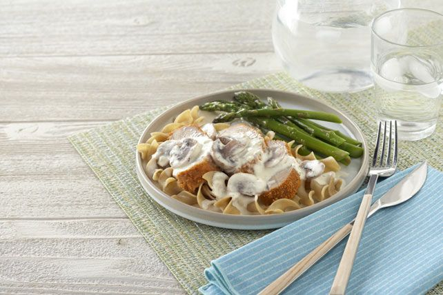 Crispy pork and a creamy chive and onion sauce get paired with asparagus for a tasty meal that'll get your family psyched about eating veggies.
