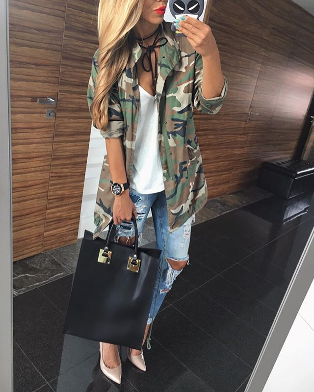 Distressed jeans, white t-shirt, nude heels, camouflage jacket or army green jacket and black or neutral purse.