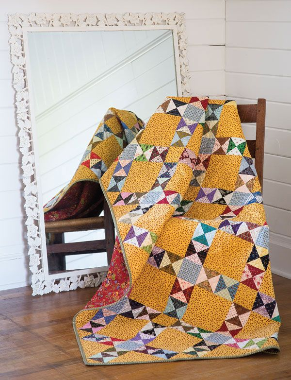 This quilt defines scrappy! Use leftover fabrics from other projects or new fabrics from your stash to create this anything-goes quilt.