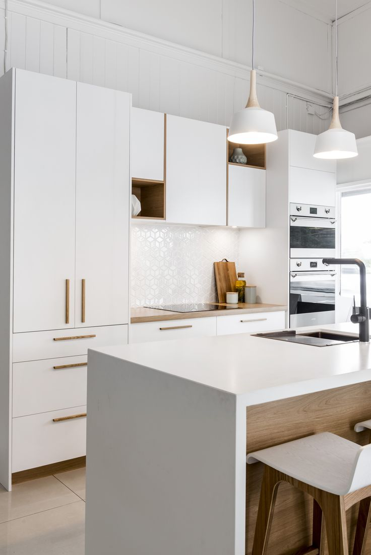 Our Scandinavian style kitchen display showcases many of the essential elements of a Scandinavian kitchen including a mix of white and timber colour cabinetry and a functional and clean streamlined design. Staying true to the minimal aesthetic of Scandinavian style interiors, our display features a pocket door pantry designed to store, while also concealing, everyday items conveniently.