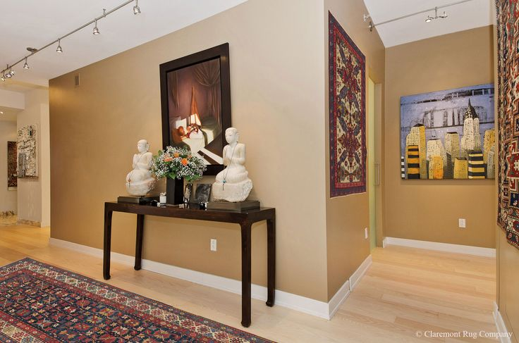 An Uniquely Eclectic Art Collection is Intertwined With Expressive Caucasian Rugs– Both On the Wall and On The Floor http://www.claremontrug.com/modern-downtown-condo/an-uniquely-eclectic-art-collection-is-intertwined-with-expressive-caucasian-rugs-both-on-the-wall-and-on-the-floor/