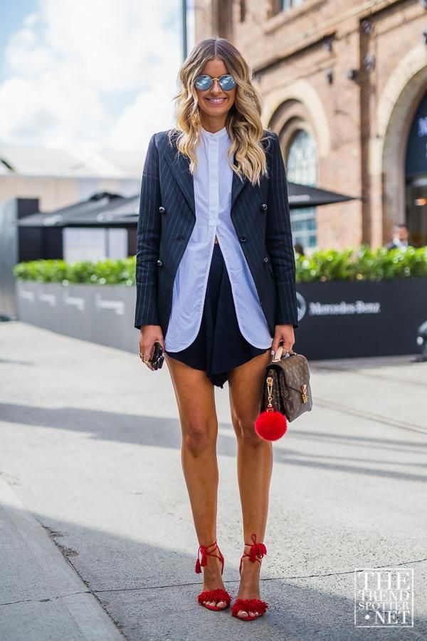Amazing Fashion Week Australia 2015 Street Style - pin stripe blazer and cut-away white button-down, handbag accessorized with a red fur pom pom, + matching red heels with fringe string ties