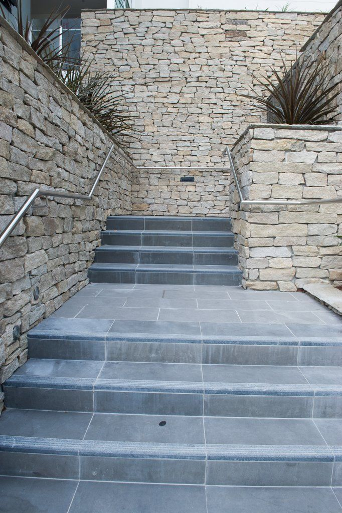 With its earthy neutral colours this cladding suits almost any colour floors, whether you choose cool grey, charcoal granite or warm beige Travertine.  #granitecladding #outdoorlife #cladding #sydneybuider #stonecladding #featurewall #outdoorenvirenment #cappingstone