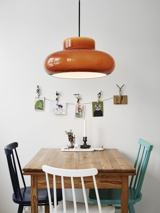 I love the different colored chairs, which colors pair wonderfully with the overhead pendant light. Mismatch chairs