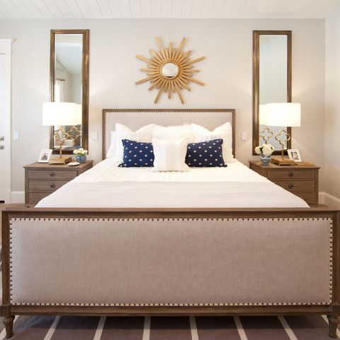I love the long, symmetrical mirrors over each nightstand ...
