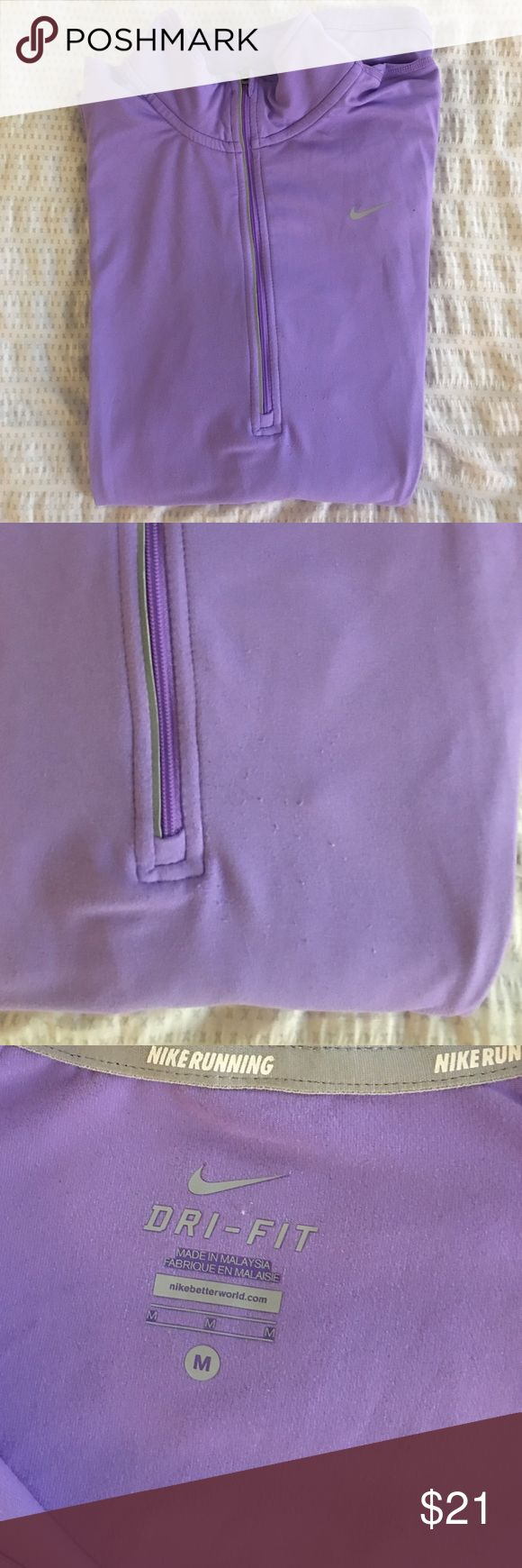 Nike pullover (lilac/light purple) Almost new Nike women's zip-up pullover, small pilling (as seen) otherwise perfect condition. Nike Tops Sweatshirts & Hoodies