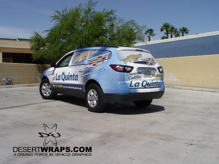 High quality and high resolution vinyl wrap on a Chevy Traverse for Chrevolet Cadillac of La Quinta. Contact us about wrapping your vehicle. DesertWraps.com 760-935-3600.  #VehicleWrap #Design #GraphicDesign #Chevy