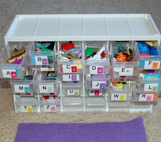 Buy a bead/hardware container then put small objects in each drawer to correspond to the beginning letter.