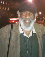 "Richard Claxton ""Dick"" Gregory (born October 12, 1932) is an American comedian, social activist, social critic, writer, and entrepreneur. Gregory is an influential American comic who has used his performance skills to convey to both white and black audiences his political message on civil rights."