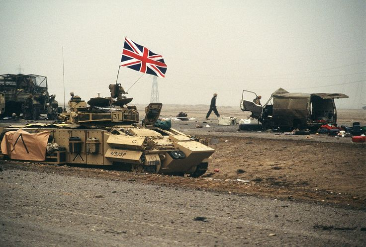 The British flag waves from an armored personnel carrier ...