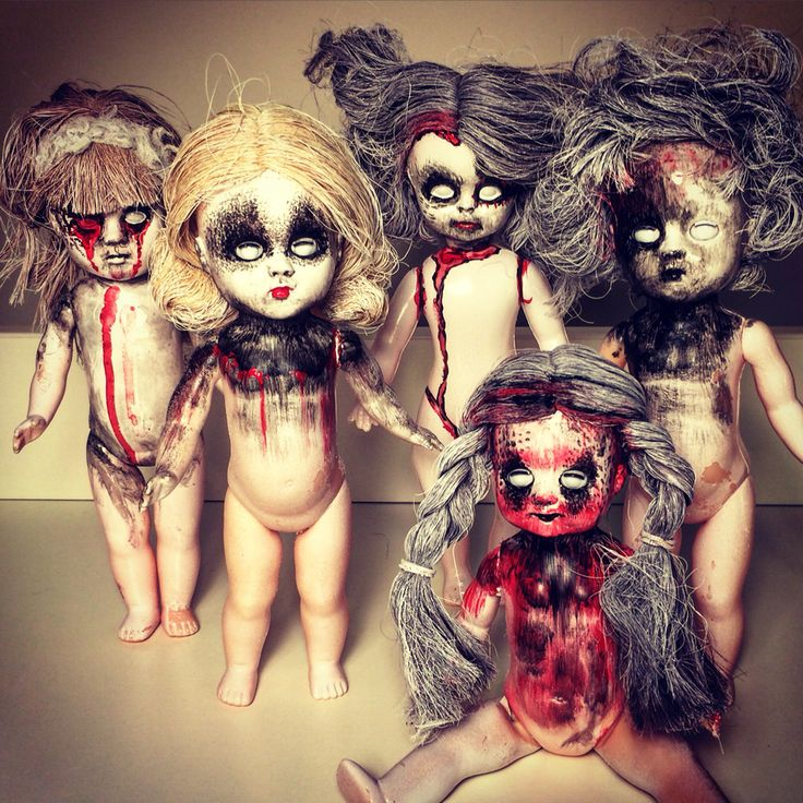 DIY Creepy dolls for our Halloween entry. I altered dolls I had from my childhood. Took off their clothes, used a white spray paint to coat the bodies and hair a little. Then used acrylics to add details back to the faces and bodies. Finish it off with a Matt fixative or any clear coat to help the paint last.