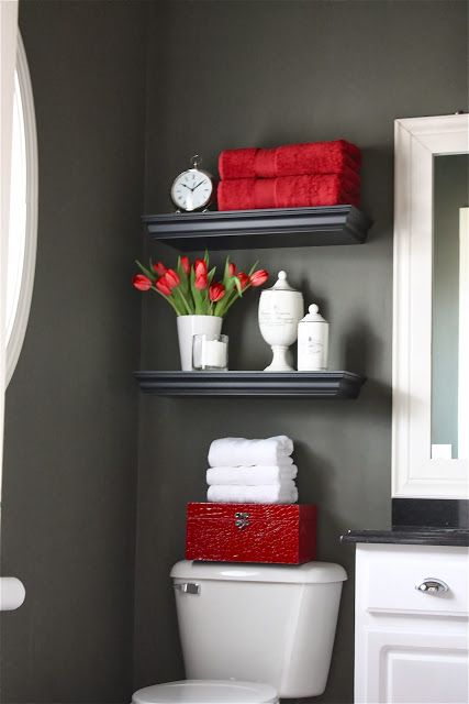 Storage shelves mounted above the toilet in a guest bathroom take up no extra space.  More on www.easyDIY.co.za