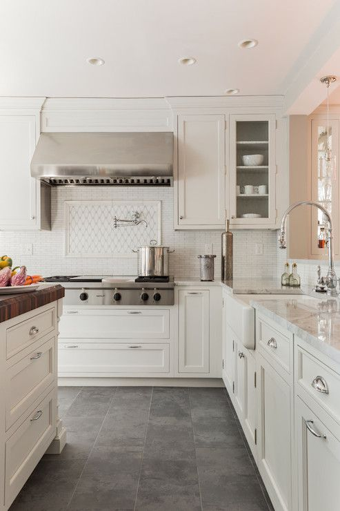gray tile floor quartz counters butcher block island creamy white cabinets paired with supreme white quartzite countertops