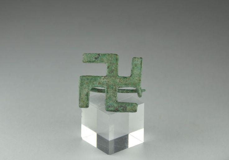 Roman swastika fibula, roman bronze swatika brooch, 1st-3d century A.D. Roman swastika fibula, roman bronze swatika brooch. Private collection