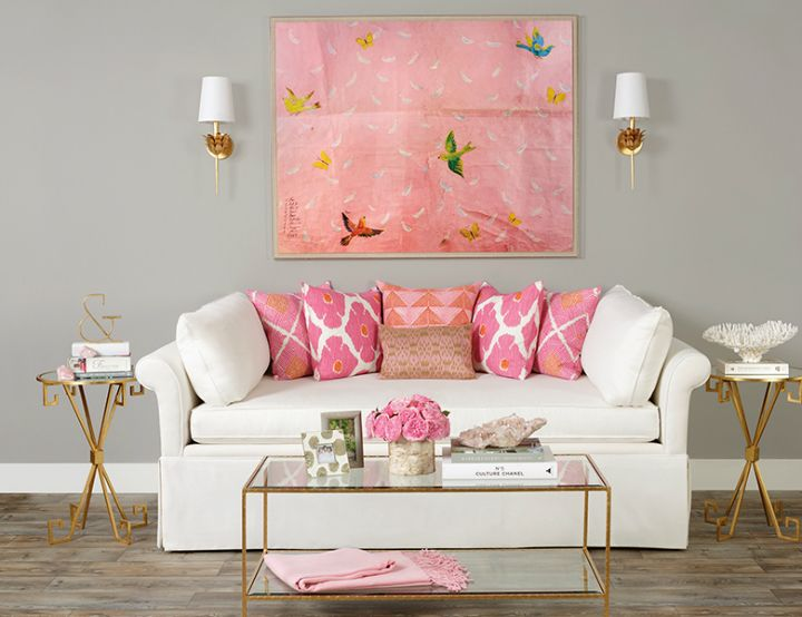high fashion home gray wall living room idea with pink art and pillows