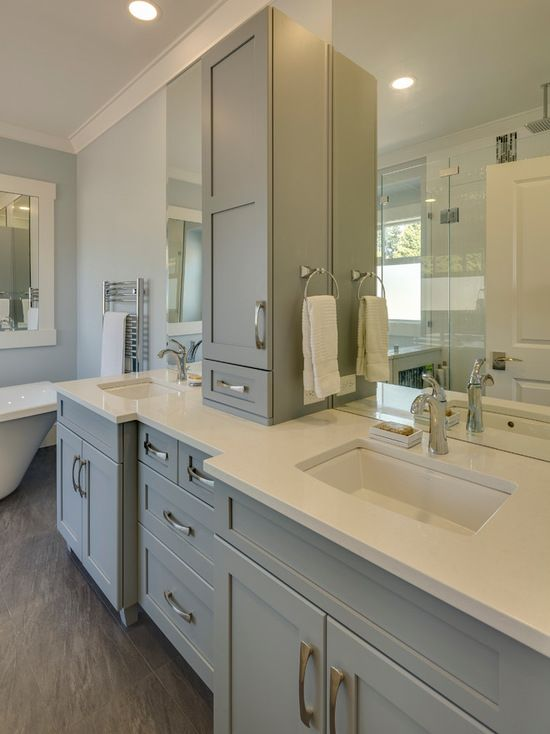 Gray & White bathroom with his and her vanity's.