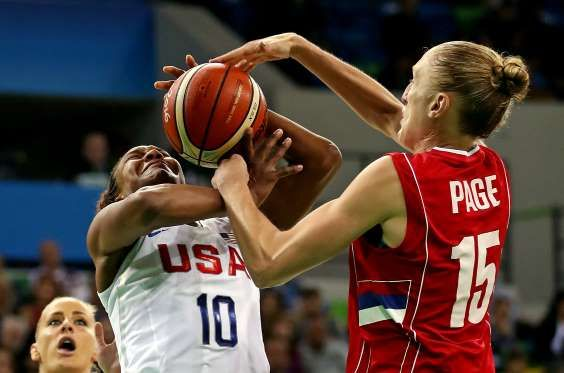 USA forward Tamika Catchings (10) and Serbia power forward Danielle Page (15) go for a rebound durin... - Jason Getz-USA TODAY Sports