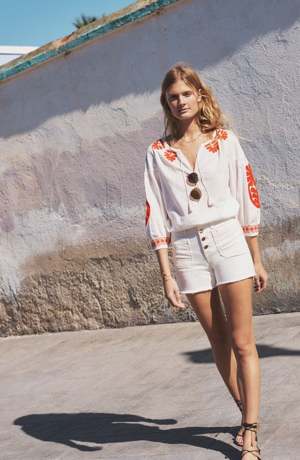 Summer calls for white denim shorts. These frayed, high-waisted, exposed button ones are the ultimate essential.