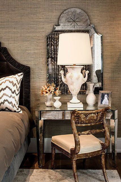 The bedroom features a mirrored desk, nightstands, mirrors and coffee table custom designed by Andrews and grasscloth wallpaper by Romo.