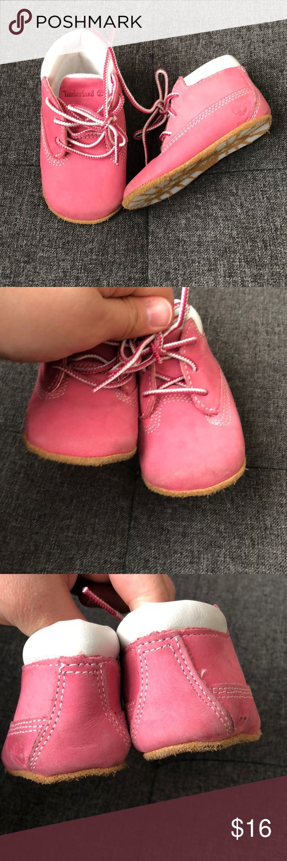 Timberland pink leather lace up boots sz 2 baby Baby girl pink lace up leather timberland boots. They do show wear from regular wear. Size 2. Timberland Shoes Boots