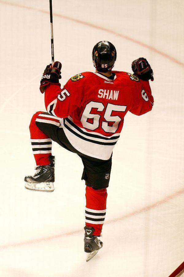 CHICAGO, IL - JUNE 12: Andrew Shaw #65 of the Chicago Blackhawks celebrates after they won 4-3 in the third overtime against the Boston Bruins in Game One of the 2013 NHL Stanley Cup Final at United Center on June 12, 2013 in Chicago, Illinois. (Photo by Gregory Shamus/Getty Images)