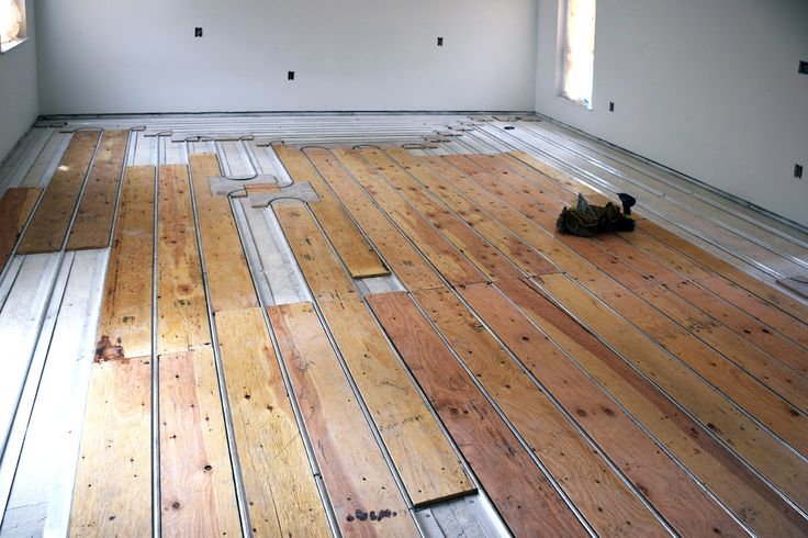 This is the state-of-the-art method of installing hydronic radiant heated  floors, using ThermoFin extruded aluminum heat transfer plates from Radia… - This Is The State-of-the-art Method Of Installing Hydronic Radiant