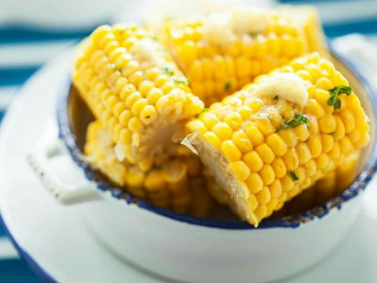 Remove 'handle' of corn, leave in husk, and place in the microwave for 2-4 minutes. Cob should slip out, cooked and ready to eat.