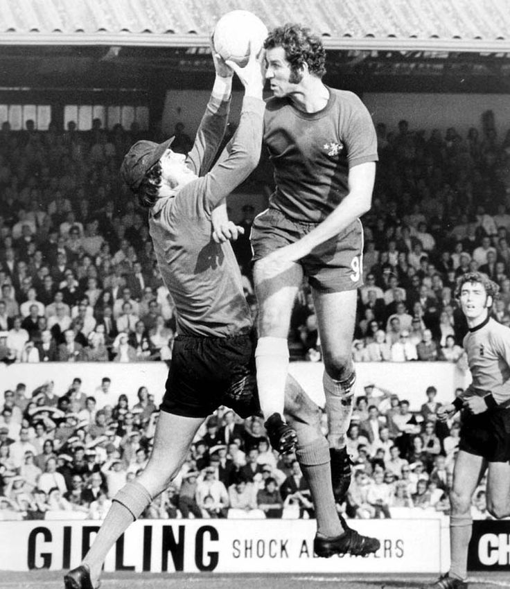 2nd October 1971 Wolves goalkeeper Phil Parkes withstands a buffeting from Chelsea's Peter Osgood at Stamford Bridge.