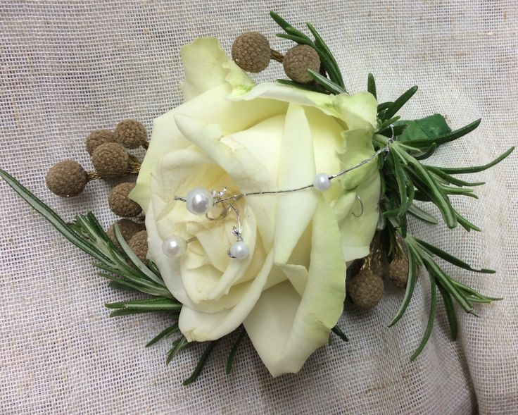 Ivory gold and pearl groom's button hole by Cathey's flowers