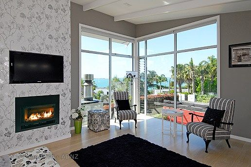Elegant room with fireplace designed by Merv Sandford #adnz #fireplace