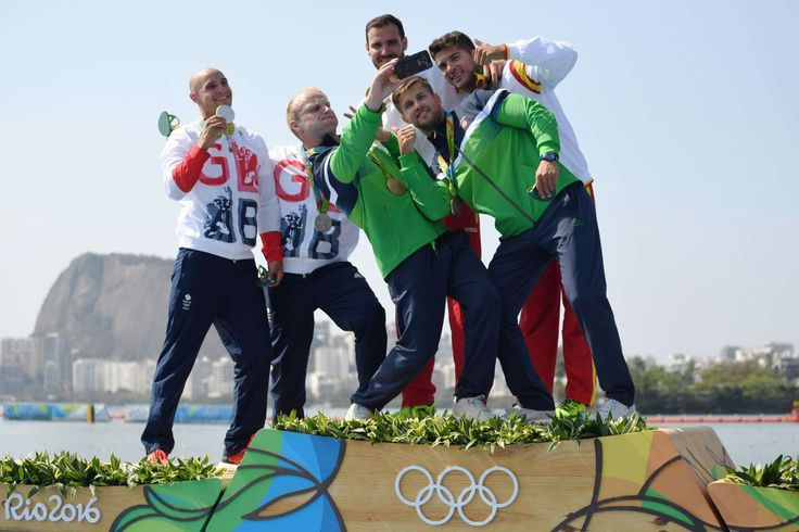 Liam Heath and Jon Schofield (GBR), Aurimas Lankas and Edvinas Ramanauskas (LTU) and Saul Craviotto and Cristian Toro (ESP) pose for a selfie during the medal ceremony for the men's kayak double 200m sprint.