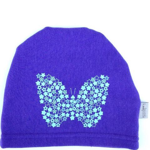 Butterfly on purple fleece lined bamboo: Our fleece-lined bamboo jersey, graphic print hat is a family favorite amongst the House of Koopslie community.  It is the perfect accessory for everyday wear, underneath a sports helmet or for family photos.  Our graphic hats are made out of our favourite fleece-lined bamboo blend – 66% bamboo, 28% cotton, 6% spandex and 100% awesome.