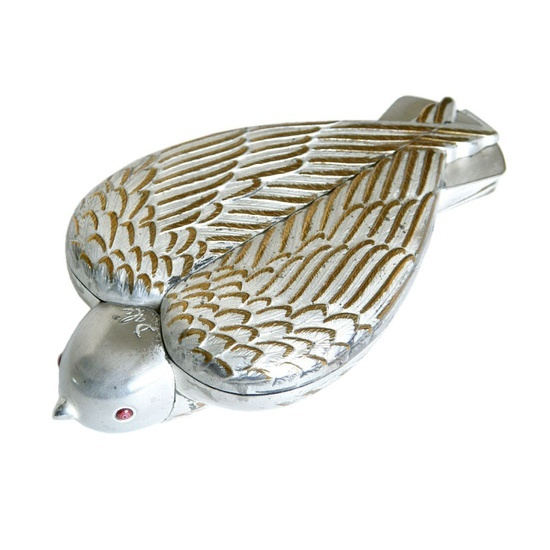 Bird in Hand Sterling Silver Compact (1950) by Salvador Dalí--this is a famous piece by artist Dali; the opposite side is just as interesting, and it includes a lipstick holder as well as a compact.