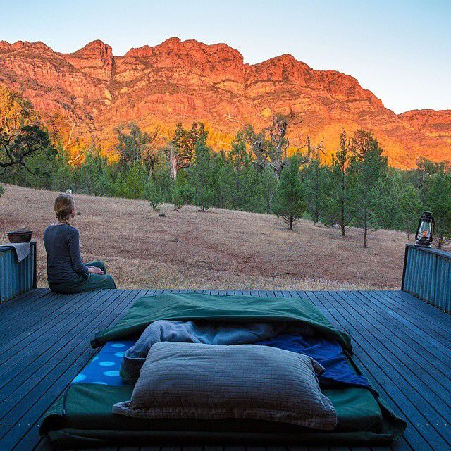 Now this is a view that we wouldn't mind waking up early for. @insta_graham23 took this shot as the sun was rising and lighting up these magnificent mountains in the Flinders Ranges. He spent the night sleeping on this swag deck as part of the @GreatWalksOfOz #ArkabaWalk in @southaustralia....the perfect place to fall asleep under the stars after a day of scenic hiking.