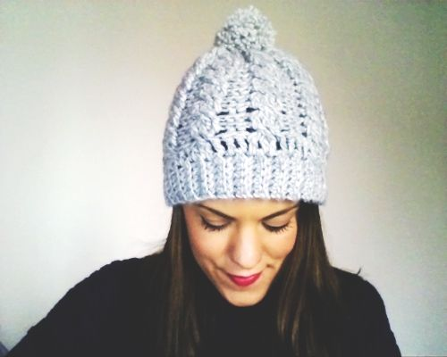 a cabled crochet hat with a nice pompom on top..I simply adore it !