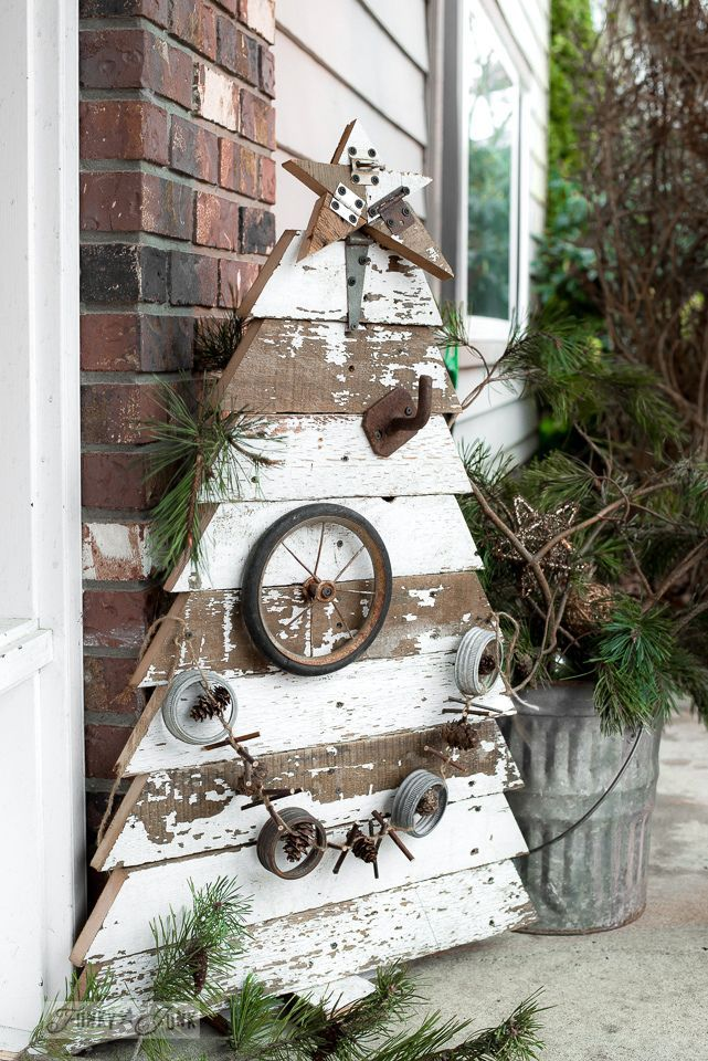 Reclaimed wood Christmas tree and star in chippy white boards for a front porch / funkyjunkinteriors.net